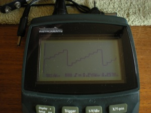 A photo of a scope reading of the signal at TP 26 showing stepped wave