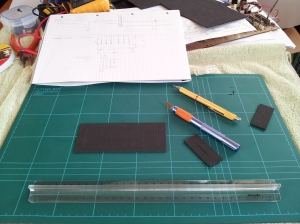 photo of cutting a replacement neoprene dust sheet for a Moog Rogue
