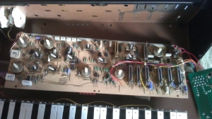 photo of a Moog Rogue open with PCBs removed for work