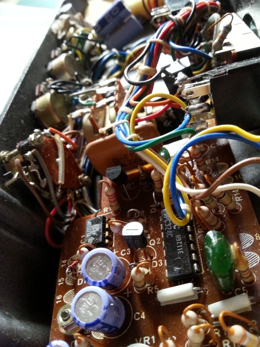 Inside the Korg MS-04 modulation pedal. So many wires!